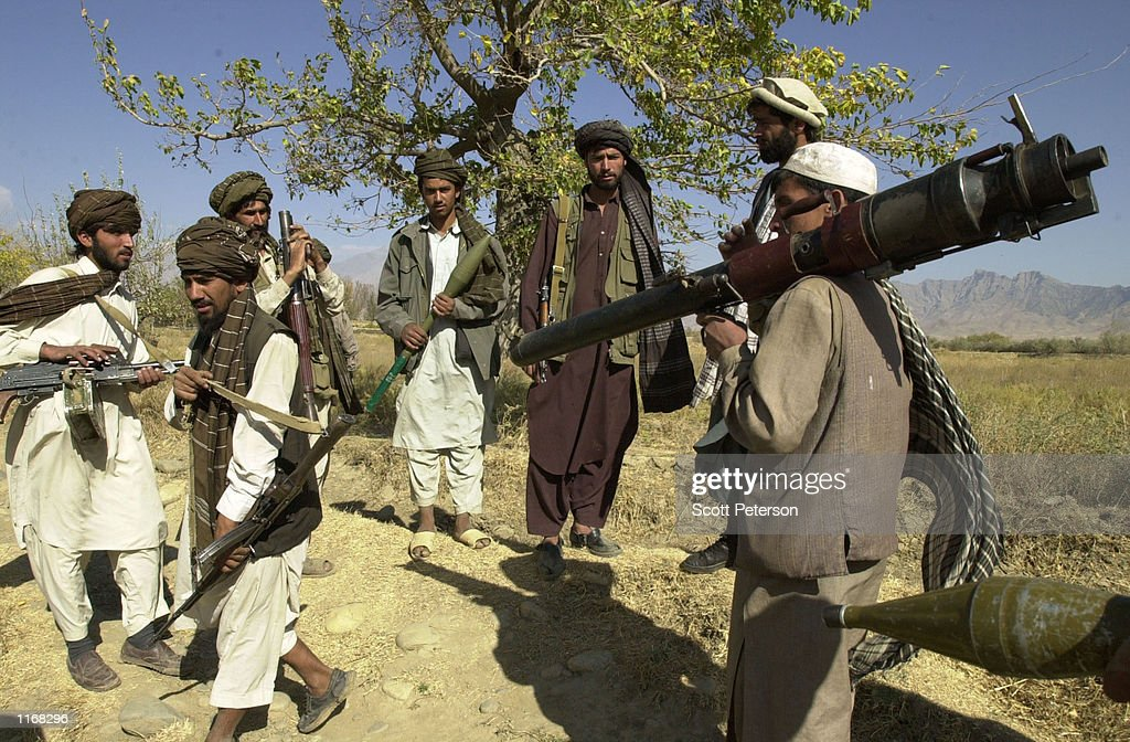 Defectors from the radical Islamic Taliban militia arrive October 17 2001 in Northern Allianceheld territory at the Jamchi front north of Kabul...