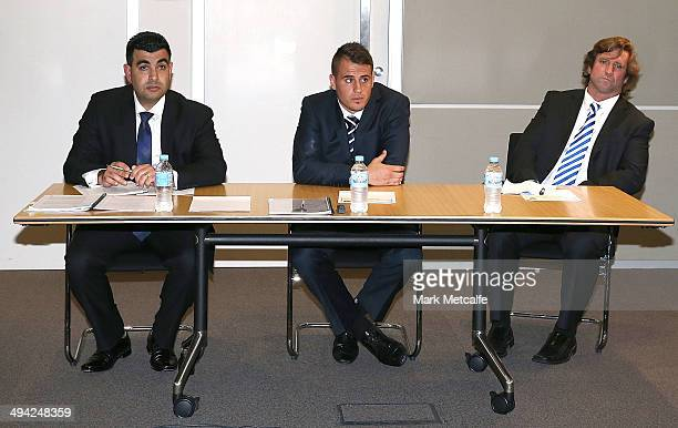 Defence Council Nick Ghabar Josh Reynolds and Bulldogs coach Des Hasler wait for the start of an NRL Origin judiciary hearing into his dangerous...