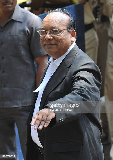 Defence Lawyer of the suspected lone surviving gunman of the 2008 Mumbai attacks Mohammad Ajmal Kasab KP Pawar gestures as he arrives outside the...