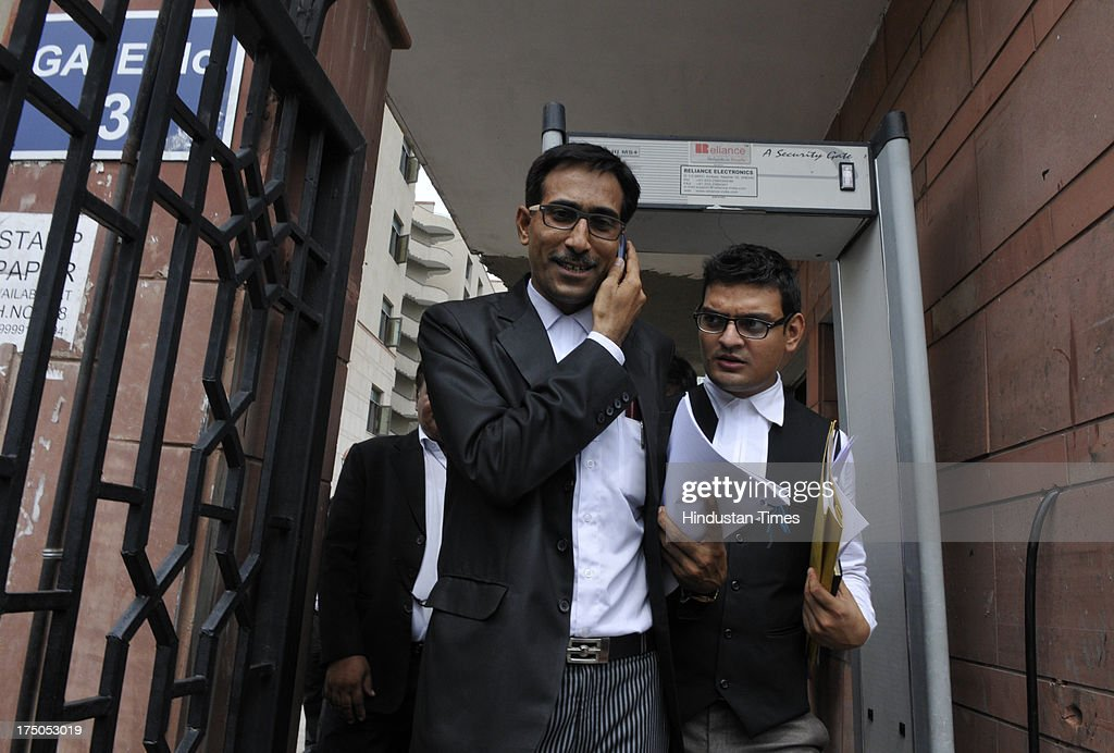 Defence Lawyer S Qamar coming out of Saket court after session court awarded life term to lone suspected Indian Mujahideen operative Shahzad Ahmed in 2008 Batla House encounter case on July 30, 2013 in New Delhi, India. Shahzad, 25, was convicted in the September 19, 2008 encounter case in which Delhi police inspector was killed and two other were injured. The encounter at Batla House in Jamia Nagar took place on tip-off that terrorists allegedly involved in the September 13, 2008 serial blasts in the capital were holed up there.