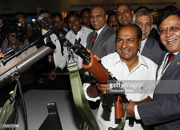 Defence Minister AK Antony holds a machine gun after the inauguration ceremony of Defexpo 2012 at Pragati Maidan on March 29 New Delhi India Indian...