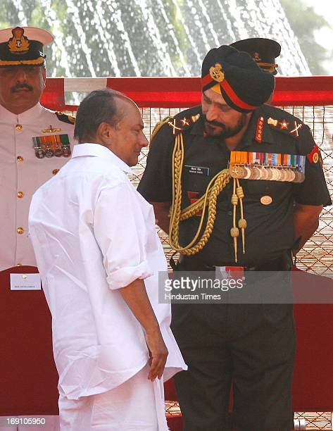 Defence Minister AK Antony talks with Army Chief Bikram Singh before ceremonial reception of Chinese Premier Li Keqiang at the forecourt of...