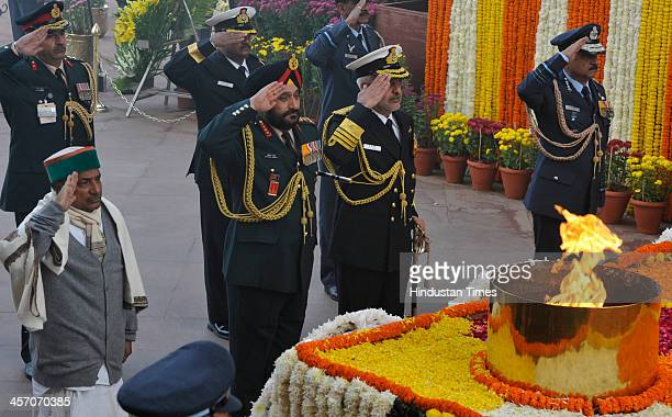 Defence Minister AK Antony with three service chiefs salute the Amar Jawan Jyoti paying homage to the martyrs at Amar Jawan Jyoti at India Gate to...