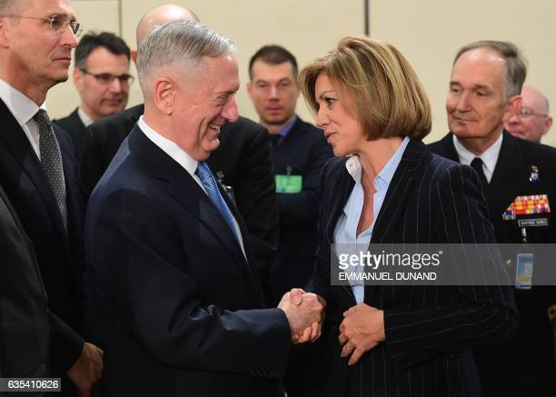 US Defence Minister James Mattis and Spain's Defence Minister Maria Dolores de Cospedal Garcia shake hands as they attend a NATO defence ministers'...