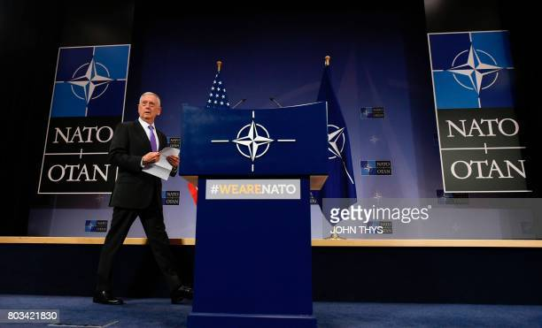 US defence minister James Mattis walks on stage prior to speak during a press conference at the Nato Defense Council meeting at the NATO Headquarters...