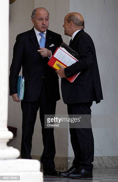 Defence Minister JeanYves Le Drian and Foreign Affairs Minister Laurent Fabius leave the Elysee Palace after the weekly cabinet meeting on January 29...