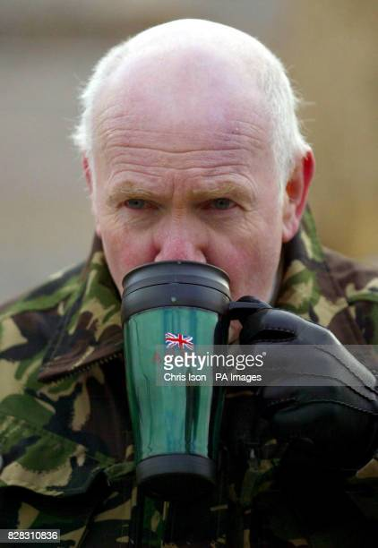 Defence Minister John Reid sips tea from an Army mug at Copehill Down Training Village on Salisbury Plain in Wiltshire Friday January 27 where he is...