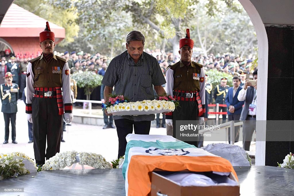Defence Minister Manohar Parrikar paying his last respect to the rescued soldier Lance Naik Hanumanthappa during his funeral ceremony at Brar square crematorium on February 11, 2016 in New Delhi, India. Lance Naik Hanamanthappa Koppad of 19 Madras Regiment was rescued alive on night after being buried under 35 feet of snow for six days. The lone survivor of the February 3 Siachen avalanche that claimed the lives of nine soldiers, breathed his last at the Army RR Hospital in Delhi.
