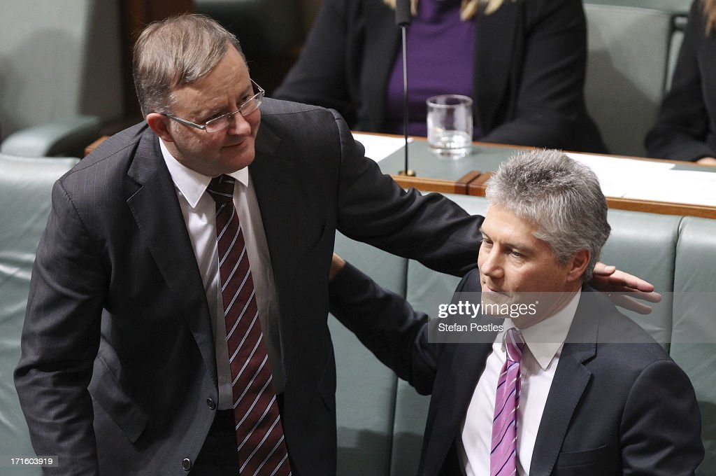 Defence Minister Stephen Smith receives a pat on the back from Deputy Prime Minister Anthony Albanese after announcing he will not contest his seat in the upcoming election in the House of Representatives on June 27, 2013 in Canberra, Australia. Kevin Rudd won an Australian Labor Party leadership ballot 57-45 last night, and will be sworn in this morning as Australian Prime Minister by Governor-General Quentin Bryce. Rudd was Prime Minister from 2007 to 2010 before he was dumped by his party for his deputy Julia Gillard. Gillard has announced that she will leave parliament and not contest her seat following her ballot loss.