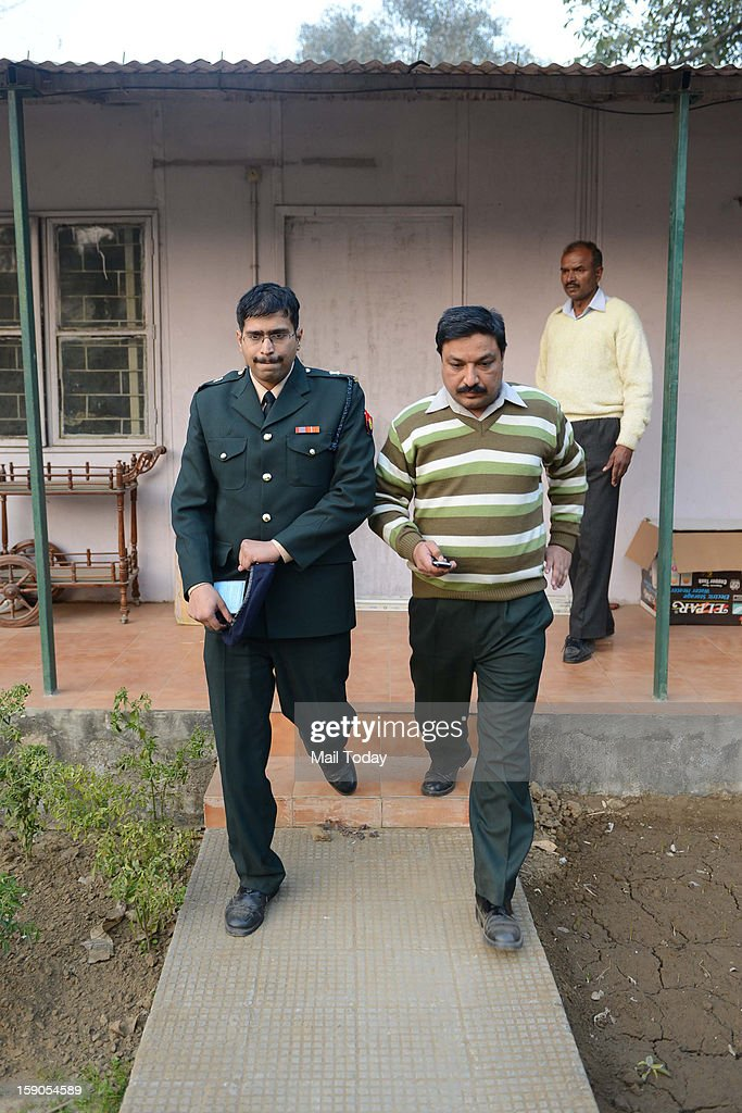 Defence personnel being taken into custody for Spying at ex Army Chief VK Singh's residence at Delhi Cantt area, on Saturday.