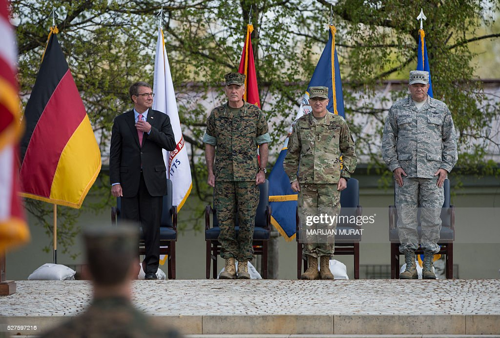 US Defence Secretary Ashton Carter, US General Joseph Dunford, US General Curtis Scaparrotti and US General Philip Breedlove take part in a ceremony on May 3, 2016 at the Patch Barracks in Stuttgart, southern Germany. Carter attended a ceremony as US General Curtis Scaparrotti was introduced as Commander of the US European Command, taking over from US General Philip Breedlove. / AFP / dpa / Marijan Murat / Germany OUT
