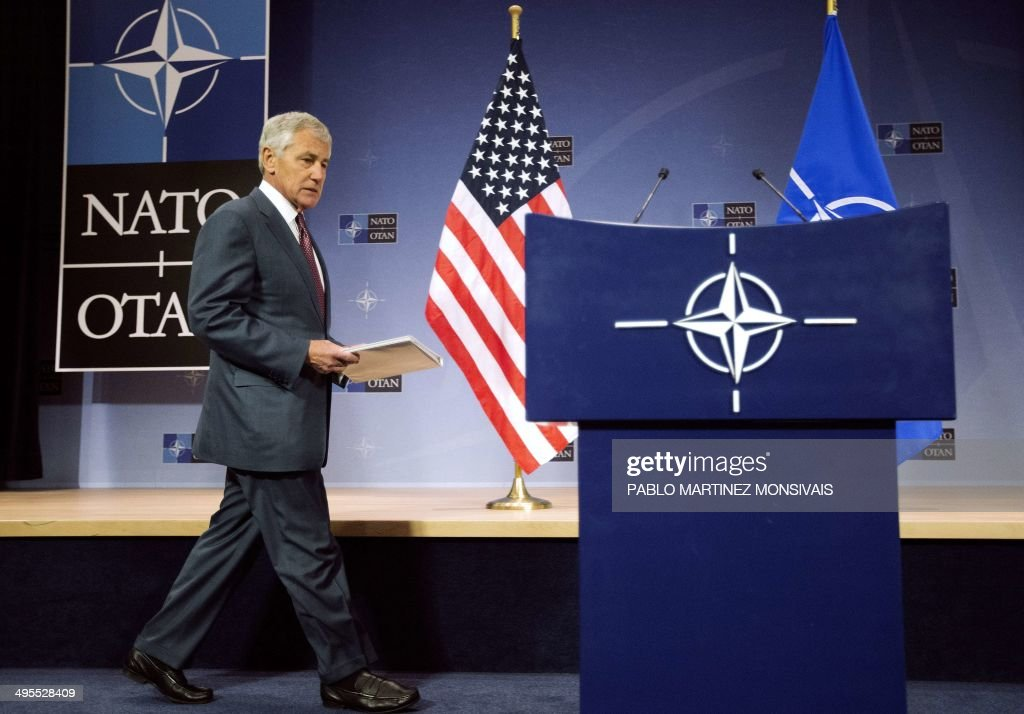 US Defence Secretary Chuck Hagel walks to the podium during a press conference at the conclusion of a North Atlantic Treaty Organization (NATO) defence ministers' meeting at the NATO headquarters in Brussels, on June 4, 2014. NATO defence ministers agreed on June 3 to a series of steps to bolster protection in eastern Europe after the Ukraine crisis, but insisted they were acting within the limits of a key post-Cold War treaty with Moscow. AFP PHOTO / POOL / PABLO MARTINEZ MONSIVAIS