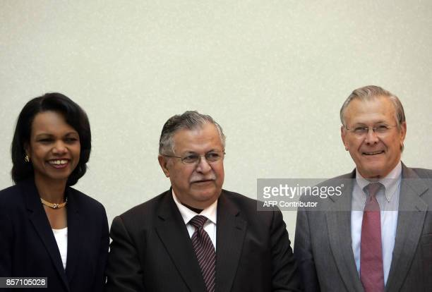US Defence Secretary Donald Rumsfeld and US Secretary of State Condoleezza Rice pose with Iraqi President Jalal Talabani at the Presidential Council...
