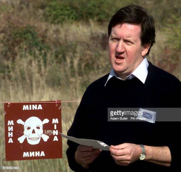 Defence Secretary George Robertson announcing a major new British landmines initiative during his visit to a Bosnian minefield near Mostar today...