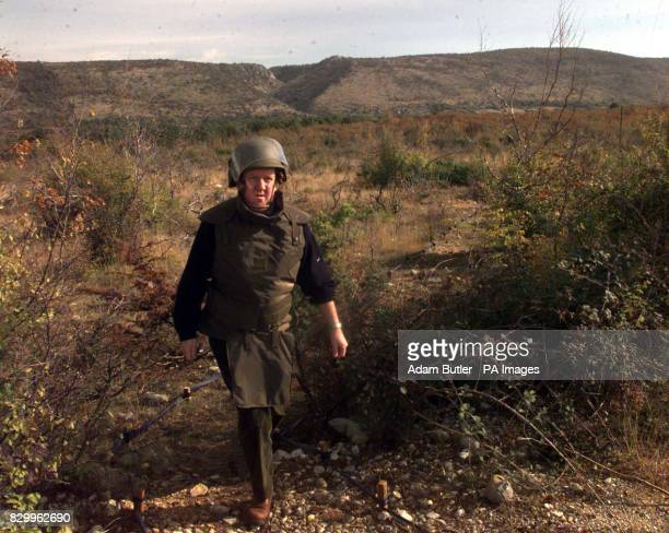 Defence Secretary George Robertson in protective headgear and flack Jacket on a visit to a Bosnian minefield near Mostar before announcing a major...