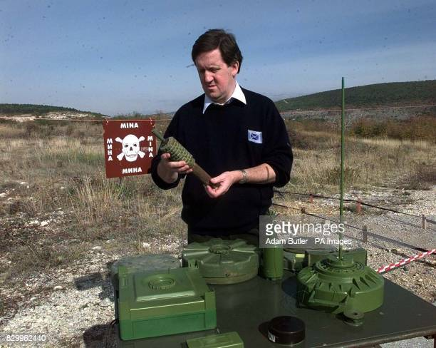 Defence Secretary George Robertson inspects a mine during a visit to a Bosnian minefield near Mostar today before announcing a major new British...