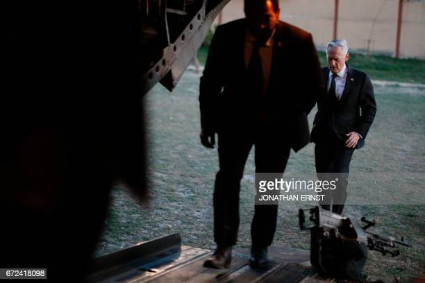 US Defence Secretary James Mattis boards a US Army helicopter after a visit to the Resolute Support headquarters in the Afghan capital Kabul on April...