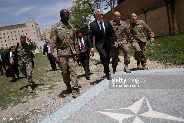 US Defence Secretary James Mattis is met by US Army Command Sergeant Major David Clark and General Christopher Haas as he arrives at Resolute Support...