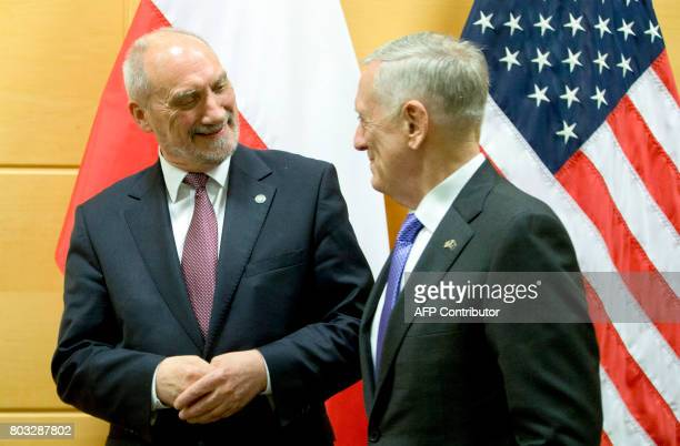 US Defence Secretary Jim Mattis speaks with Polish Defense Minister Antoni Macierewicz prior to a meeting within a NATO Defence Council meeting at...