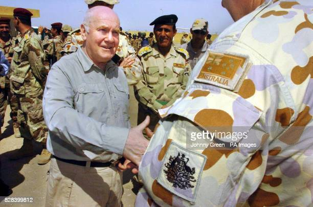 Defence Secretary John Reid meets an Australian member of the coalition forces at a military training academy in AlMuthanna southern Iraq Sunday...