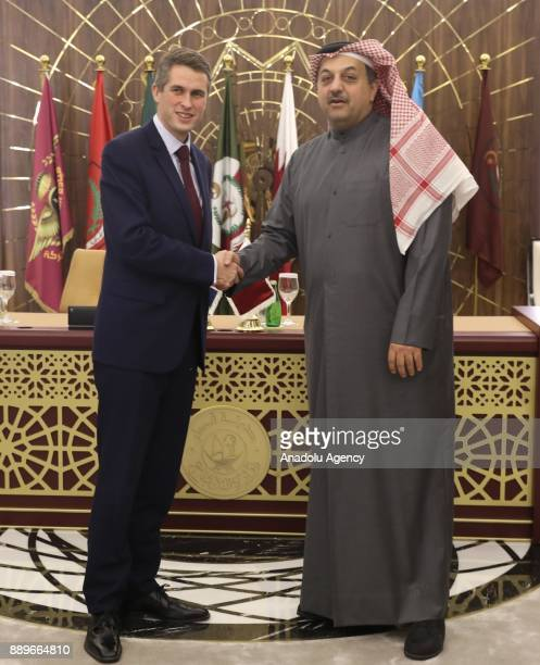 Defence Secretary of United Kingdom Gavin Williamson shakes hands with Minister of State for Defense of Qatar Khalid bin Mohammad Al Attiyah after...