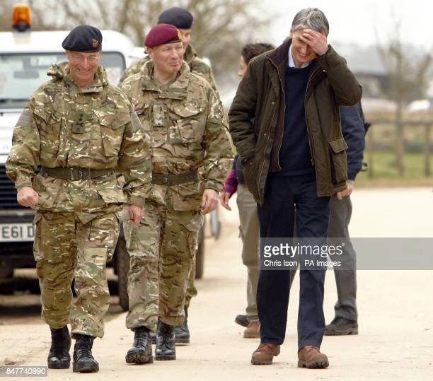 Defence Secretary Philip Hammond and Chief of the Defence Staff General Sir David Richards just after being confronted by a goat during a visit to...