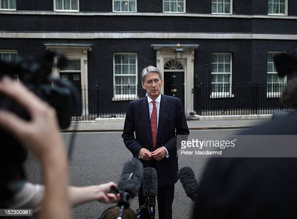 Defence Secretary Philip Hammond speaks to reporters outside Number 10 Downing Street on September 18 2012 in London England The British government...