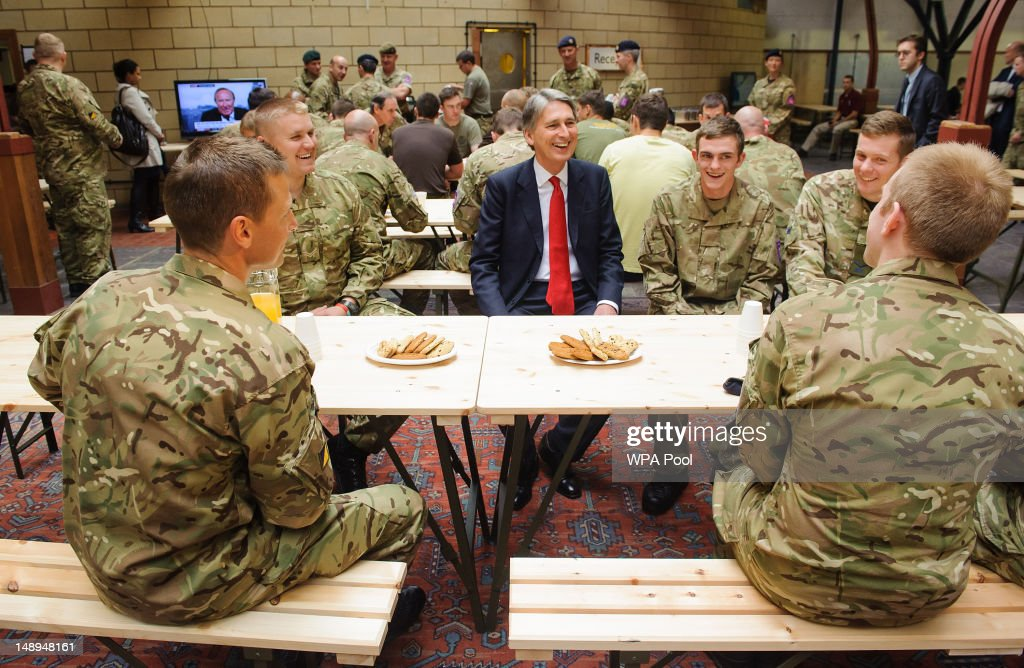 Defence Secretary <a gi-track='captionPersonalityLinkClicked' href=/galleries/search?phrase=Philip+Hammond&family=editorial&specificpeople=2486715 ng-click='$event.stopPropagation()'>Philip Hammond</a> speaks to troops during a visit to the temporary Olympic Army barracks at Tobacco Dock, a former shopping centre, on July 20, 2012 in London, England. An additional 2,500 soldiers are being housed temporarily at Tobacco Dock in Wapping, in east London, during the Games to deal with the G4S security shortfall.