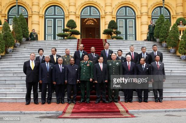 Defence Secretary Robert Gates and Vietnam president Nguyen Minh Triet pose alongside a gathering of South East Asian defence ministers outside the...
