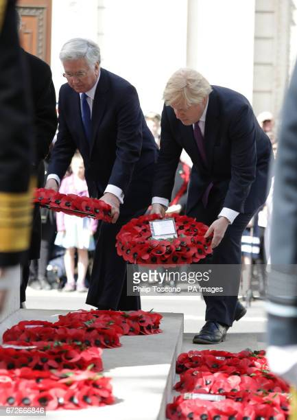 Defence Secretary Sir Michael Fallon and Foreign Secretary Boris Johnson lay wreaths at the Cenotaph in London during Anzac Day commemorations...