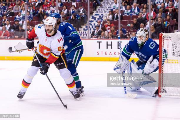 Defenceman Chris Tanev and Vancouver Canucks Goalie Jacob Markstrom defend against Calgary Flames Right Wing Jaromir Jagr during their NHL game at...