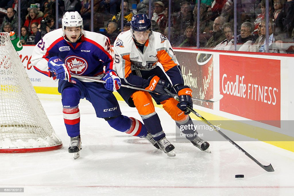 Defenceman Fedor Gordeev #15 of the Flint Firebirds moves the puck against forward Logan Brown #21 of the Windsor Spitfires on December 31, 2016 at the WFCU Centre in Windsor, Ontario, Canada.