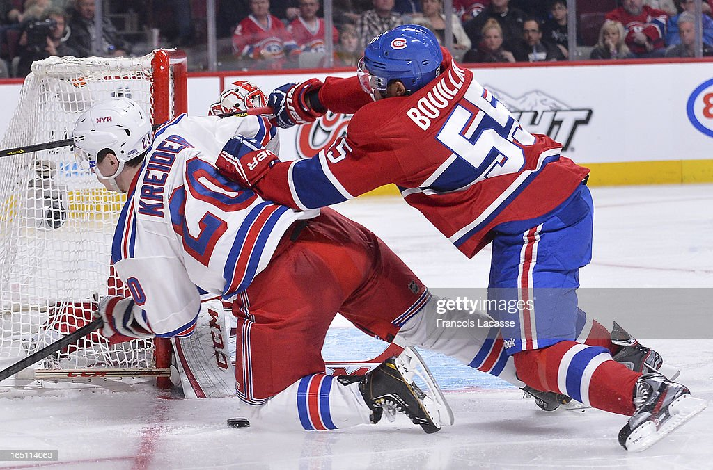 Defenceman <a gi-track='captionPersonalityLinkClicked' href=/galleries/search?phrase=Francis+Bouillon&family=editorial&specificpeople=215165 ng-click='$event.stopPropagation()'>Francis Bouillon</a> #55 of the Montreal Canadiens checks <a gi-track='captionPersonalityLinkClicked' href=/galleries/search?phrase=Chris+Kreider&family=editorial&specificpeople=5894671 ng-click='$event.stopPropagation()'>Chris Kreider</a> #20 of the New York Rangers to the ice during the NHL game on March 30, 2013 at the Bell Centre in Montreal, Quebec, Canada.