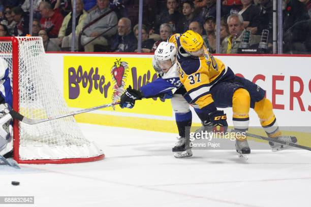 Defenceman Jakub Zboril of the Saint John Sea Dogs moves the puck against forward Warren Foegele of the Erie Otters on May 26 2017 during the...