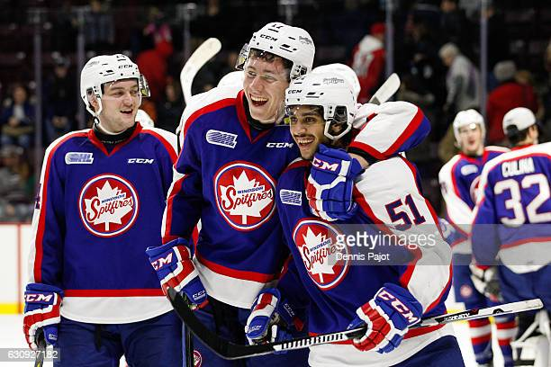 Defenceman Jalen Chatfield of the Windsor Spitfires celebrates with teammate Logan Stanley after a 51 win against the London Knights on January 3...