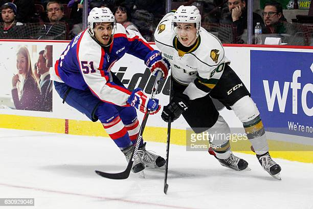 Defenceman Jalen Chatfield of the Windsor Spitfires skates against forward Alex Formenton of the London Knights on January 3 2017 at the WFCU Centre...