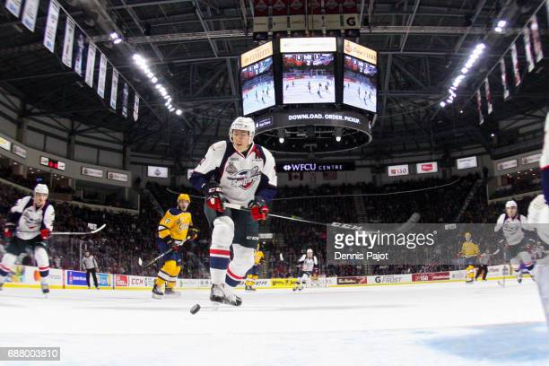 Defenceman Logan Stanley of the Windsor Spitfires moves the puck against the Erie Otters on May 24 2017 during Game 6 of the Mastercard Memorial Cup...