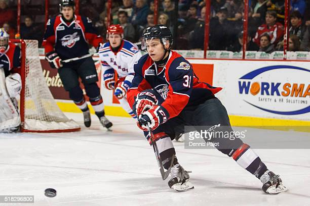 Defenceman Mikhail Sergachev of the Windsor Spitfires moves the puck against the Kitchener Rangers during game 4 of the Western Conference...