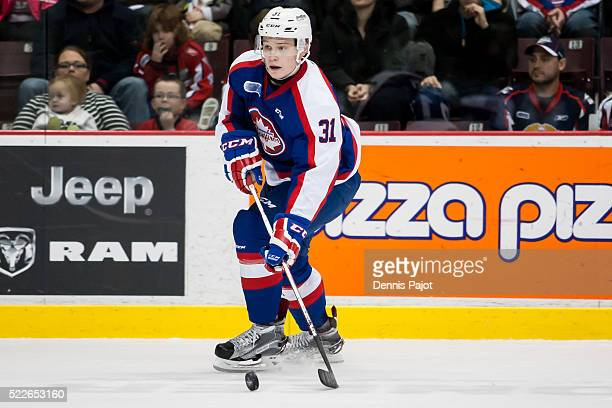 Defenceman Mikhail Sergachev of the Windsor Spitfires moves the puck against the Erie Otters on February 6 2016 at the WFCU Centre in Windsor Ontario...