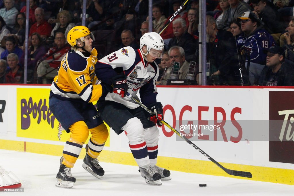 Defenceman Mikhail Sergachev #31 of the Windsor Spitfires moves the puck against forward Taylor Raddysh #17 of the Erie Otters on May 24, 2017 during Game 6 of the Mastercard Memorial Cup at the WFCU Centre in Windsor, Ontario, Canada.