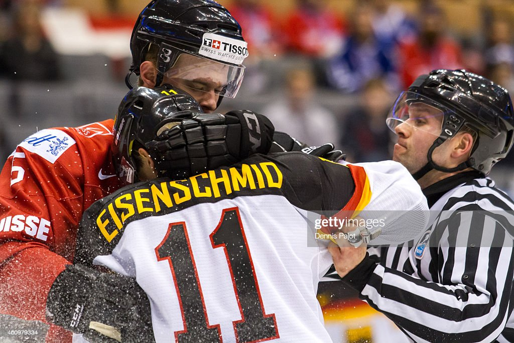 Defenceman Mirco Muller #5 of Switzerland battles in front of the net against forward Markus Eisenschmid #11 of Germany during the 2015 IIHF World Junior Championship on January 02, 2015 at the Air Canada Centre in Toronto, Ontario, Canada.