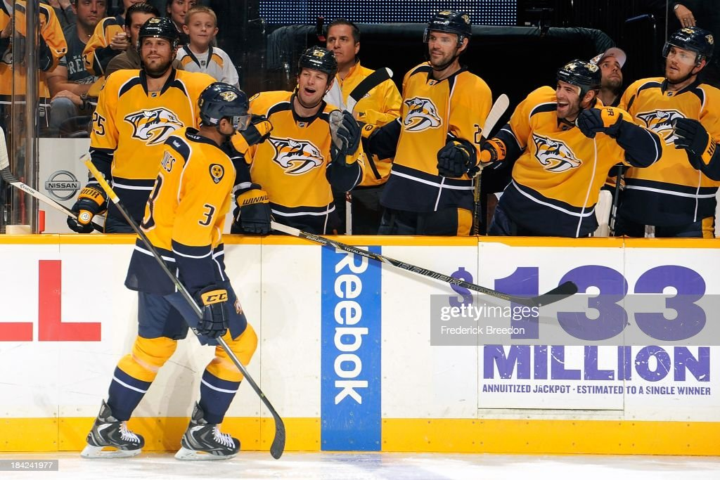 Defenceman rookie Seth Jones #3 of the Nashville Predators is congratulated by teammates on scoring his first career NHL goal against the New York Islanders at Bridgestone Arena on October 12, 2013 in Nashville, Tennessee.