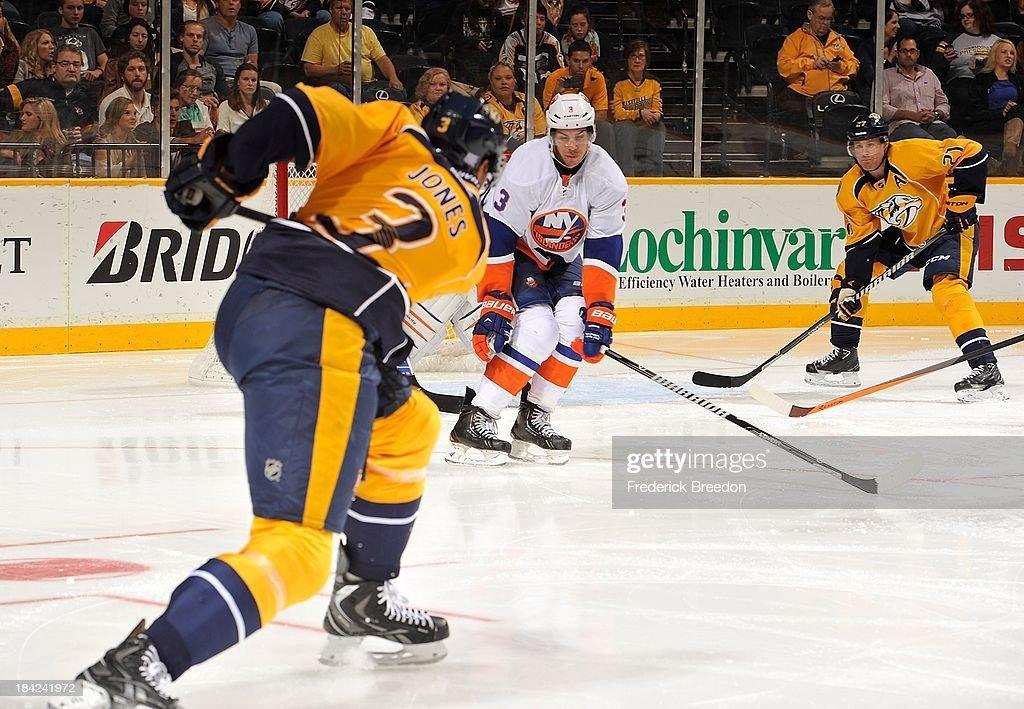 Defenceman rookie Seth Jones #3 of the Nashville Predators scores his first career NHL goal behind Travis Hamonic #3 of the New York Islanders at Bridgestone Arena on October 12, 2013 in Nashville, Tennessee.