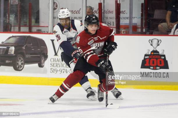 Defenceman Ryan Merkley of the Guelph Storm moves the puck against Cole Purboo of the Windsor Spitfires on September 24 2017 at the WFCU Centre in...