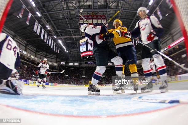 Defenceman Sean Day of the Windsor Spitfires battles in front of the net against forward Taylor Raddysh of the Erie Otters on May 24 2017 during Game...