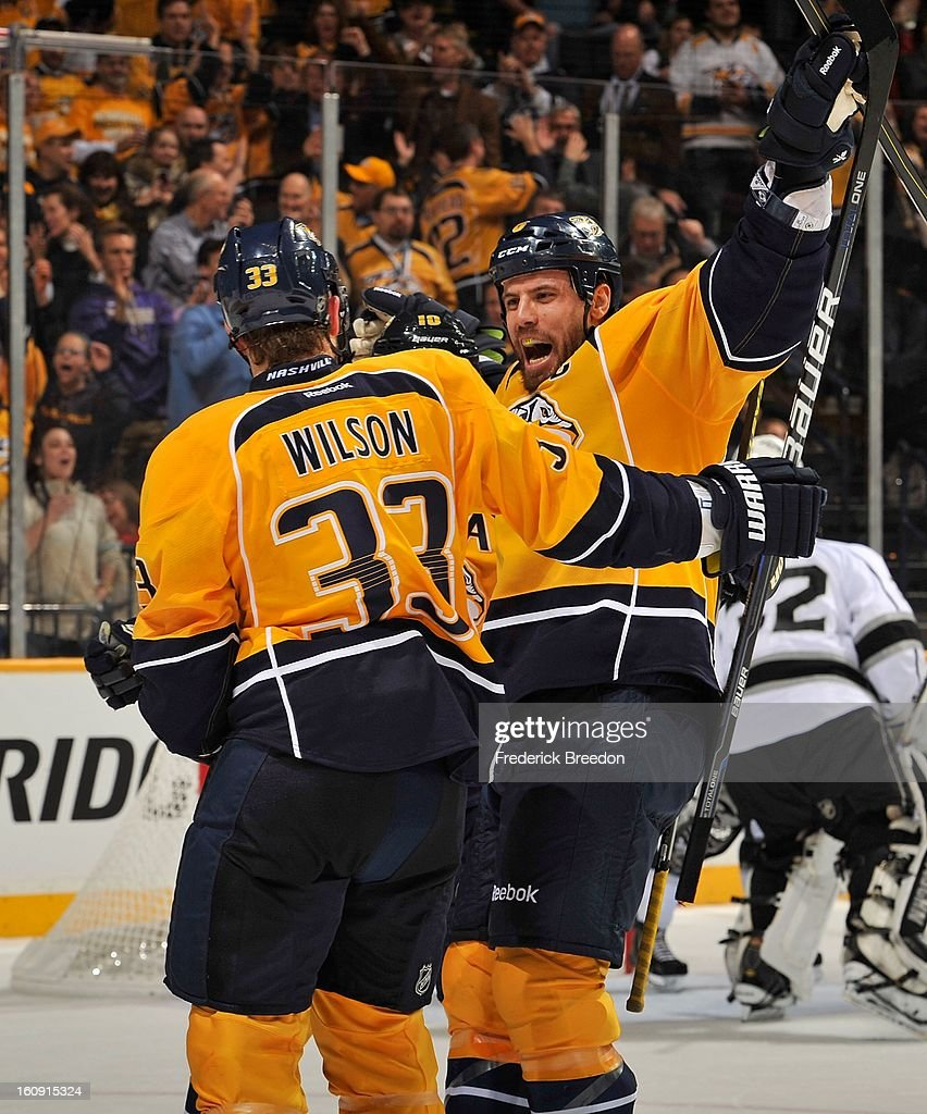 Defenceman Shea Weber #6 of the Nashville Predators congratulates teammate Colin Wilson #33 on scoring a goal against the Los Angeles Kings at the Bridgestone Arena on February 7, 2013 in Nashville, Tennessee.