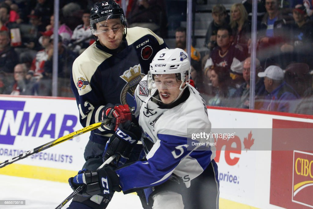Defenceman Thomas Chabot #5 of the Saint John Sea Dogs battles against forward Gabriel Vilardi #13 of the Windsor Spitfires on May 19, 2017 during Game 1 of the Mastercard Memorial Cup at the WFCU Centre in Windsor, Ontario, Canada.