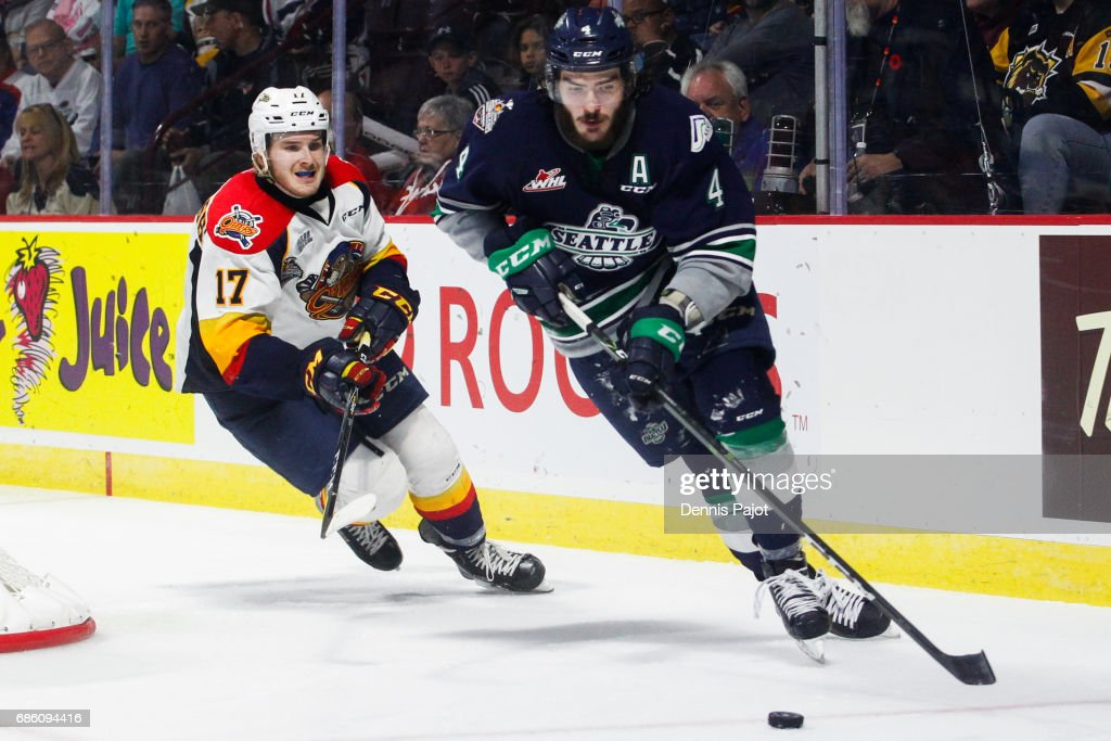 Defenceman Turner Ottenbreit #4 of the Seattle Thunderbirds moves the puck against forward Taylor Raddysh #17 of the Erie Otters on May 20, 2017 during Game 2 of the Mastercard Memorial Cup at the WFCU Centre in Windsor, Ontario, Canada.