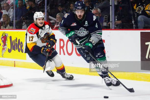 Defenceman Turner Ottenbreit of the Seattle Thunderbirds moves the puck against forward Taylor Raddysh of the Erie Otters on May 20 2017 during Game...