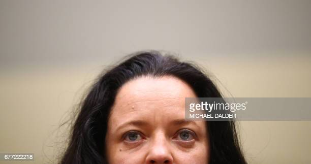Defendant Beate Zschaepe accused of helping to found a neoNazi cell the National Socialist Underground arrives for the continuation of her trial at a...